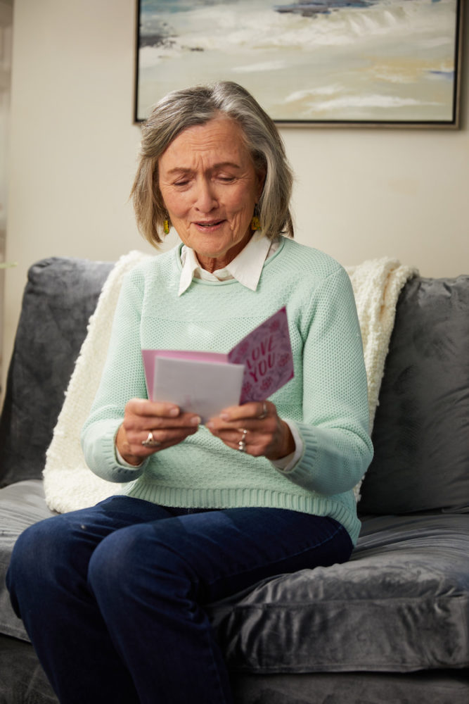 Grandma opening and reading card
