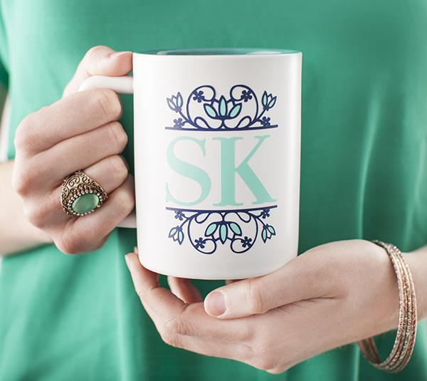 """Hands holding """"SK"""" mug"""
