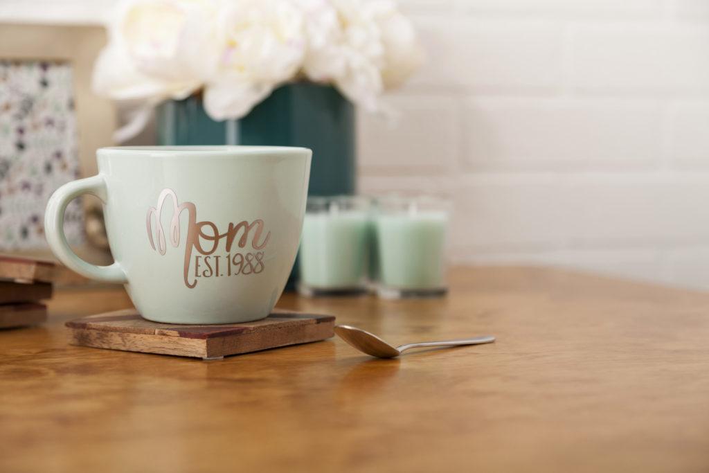 "Green mug that reads ""Mom est. 1988"""