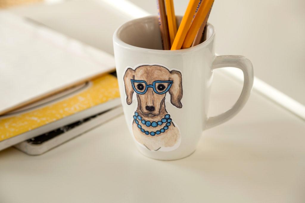 Portrait of a dog on a white mug