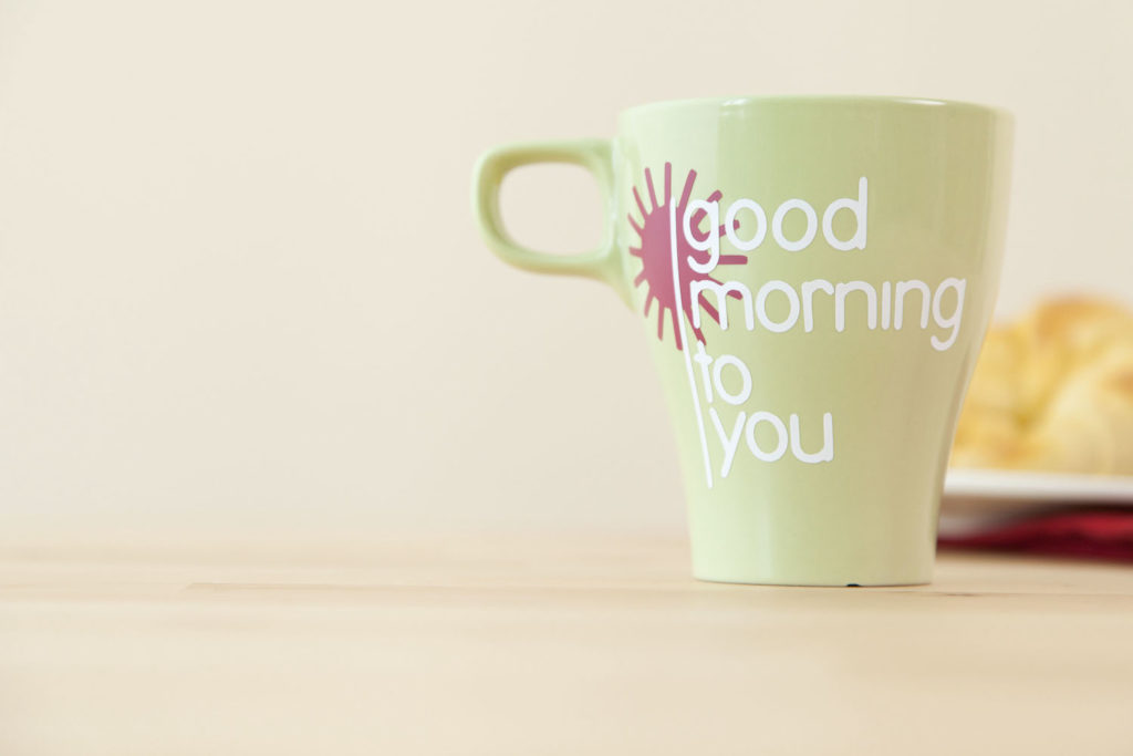 """Mug that reads """"good morning to you"""" sitting on table"""