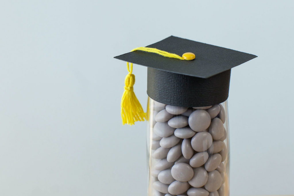 Jar of candy with graduation cap