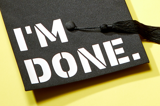 "The words ""I'm Done"" printed on graduation cap"