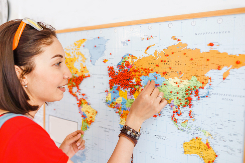 Woman pinning into world map