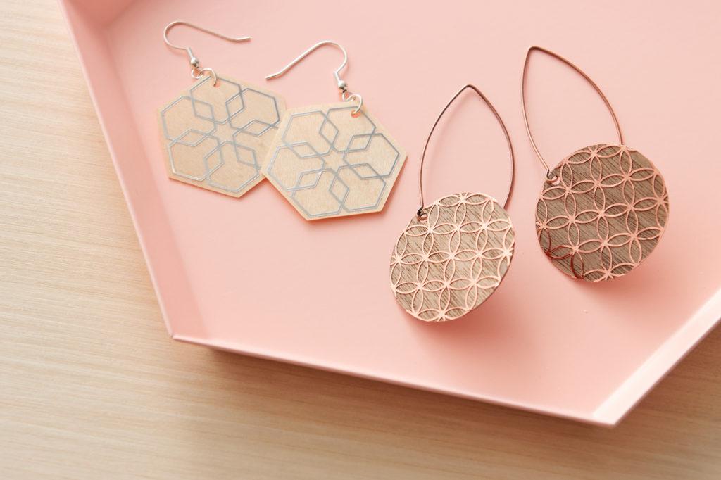 Veneer earrings on pink tray