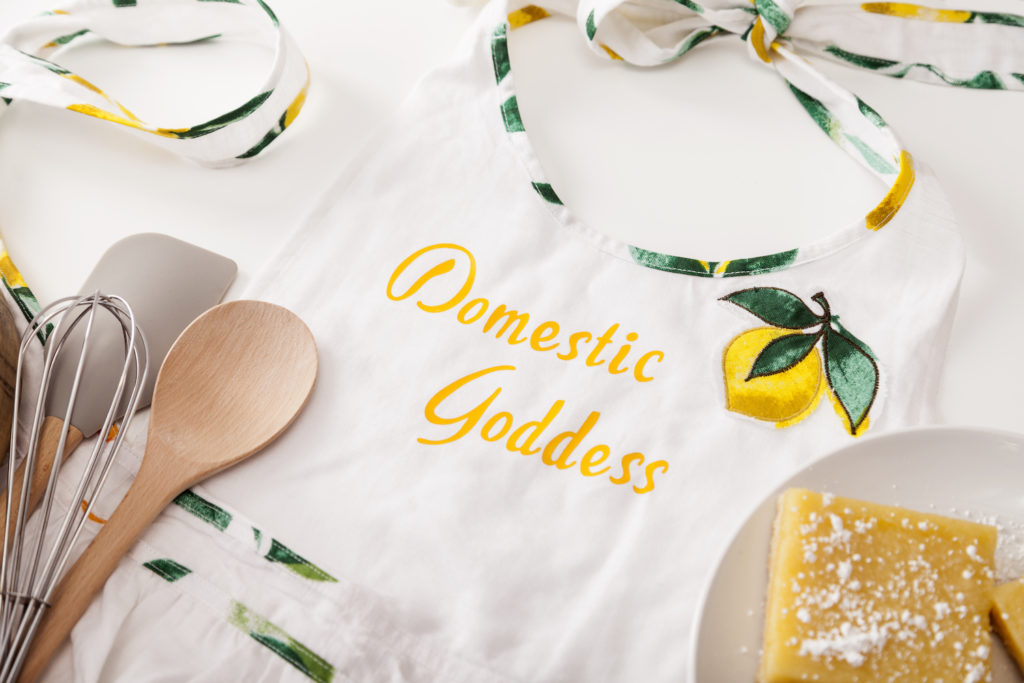 """Homemade apron that reads """"domestic goddess"""""""
