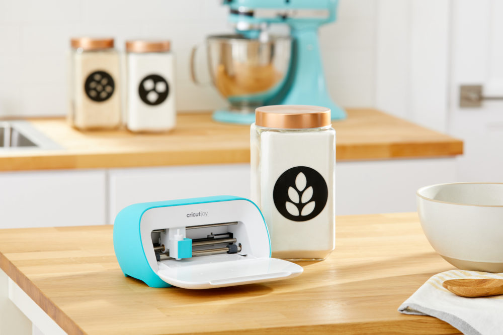 Cricut Joy on countertop with labeled jars