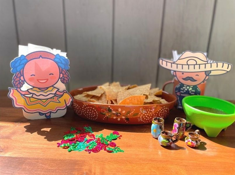 Mariachi and Folklorico girl decorations on table