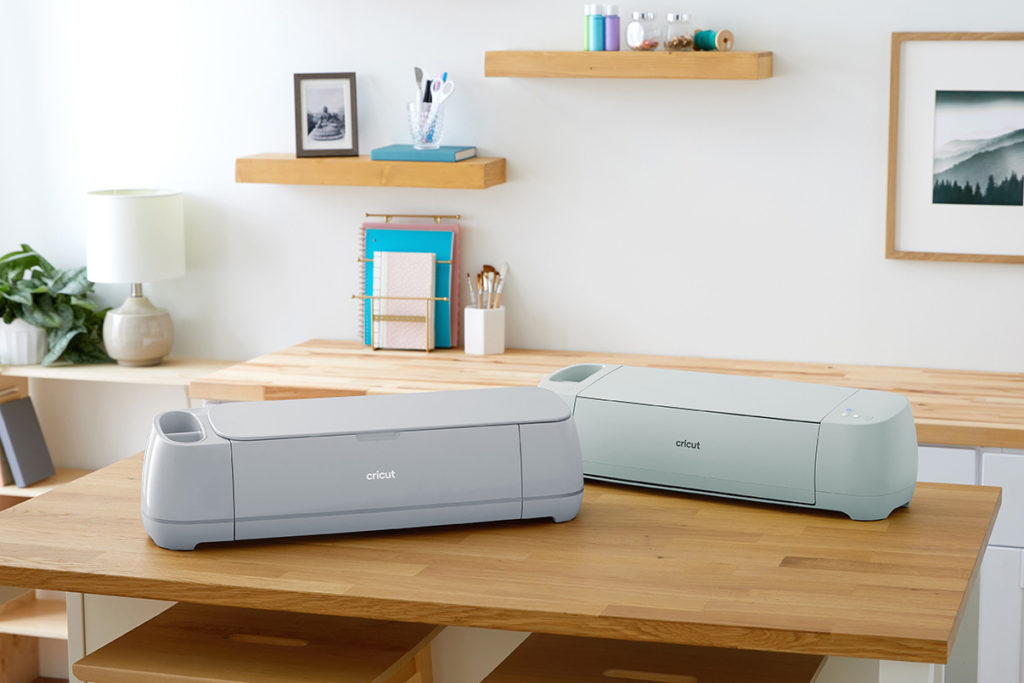Cricut Maker 3 and Cricut Explore 3 together on table