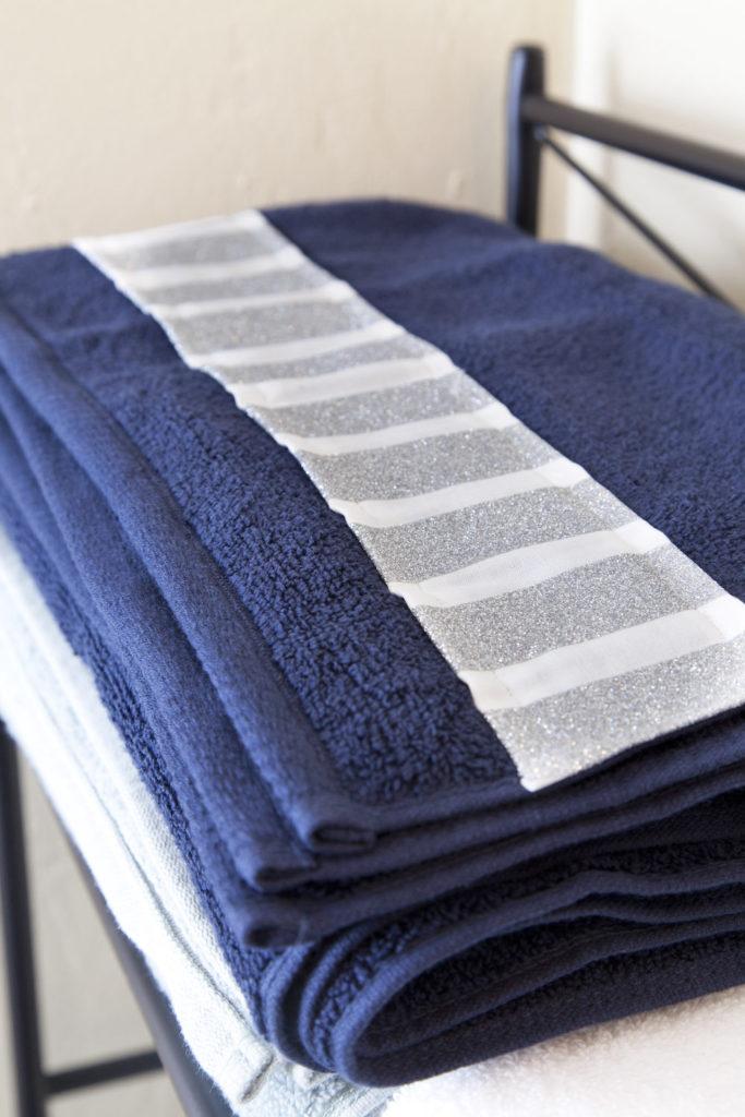 Glitter adorned bath towels
