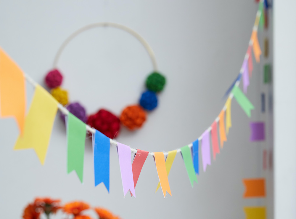 A colorful pennant is hung across a room.
