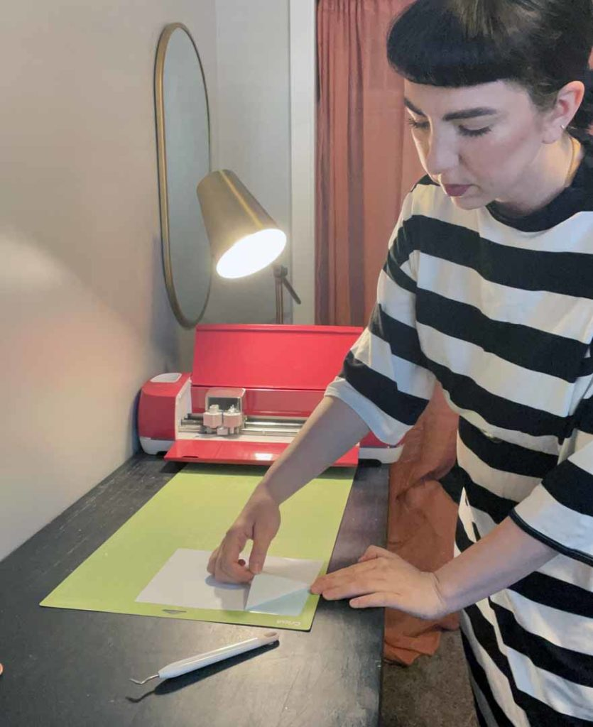 Lucy Bergstrom working with her Cricut machine