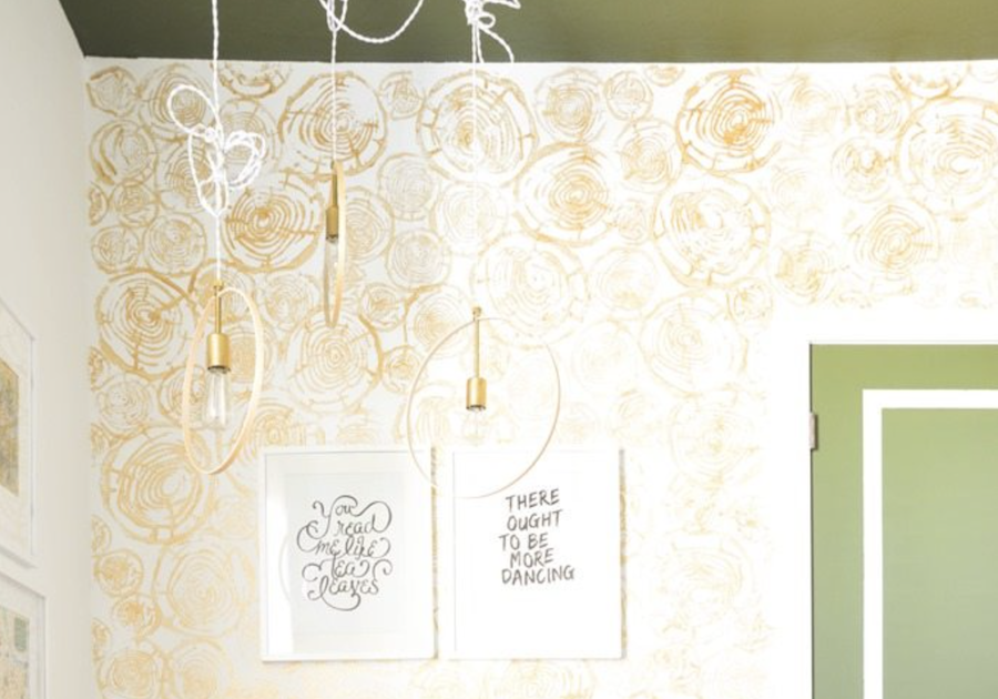 A wall is covered with a gold colored log print pattern