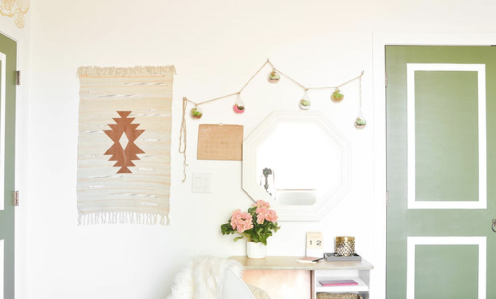 Bohemian elements and wall hangings adorn the walls of a boho bedroom