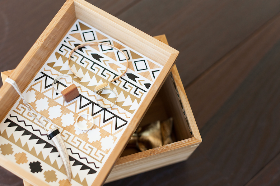 A wooden jewelry box with vinyl accents