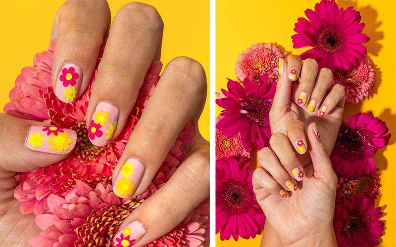 Summer nails manicured with vinyl flower decals, inspired by a '70s design theme
