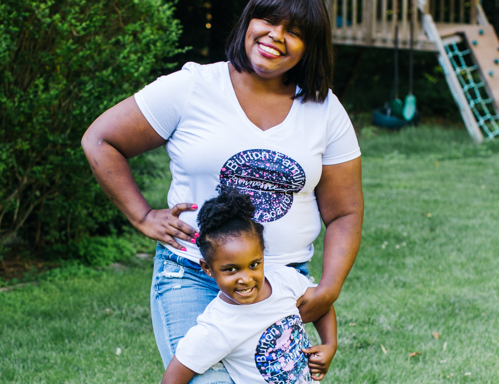 A mother and daughter wear matching custom tees, created with Cricut machines and materials for the perfect summer outfit
