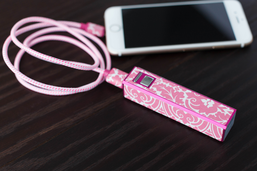 A phone charging bank is covered in a pink floral design