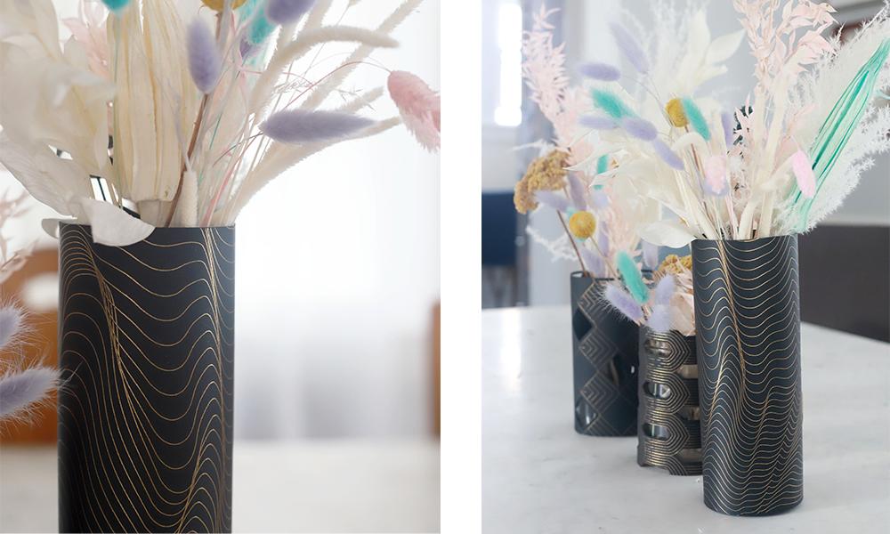 Detail shots showcase the gold foil patters on floral wedding centerpieces that sit in Cricut made black paper vase wraps