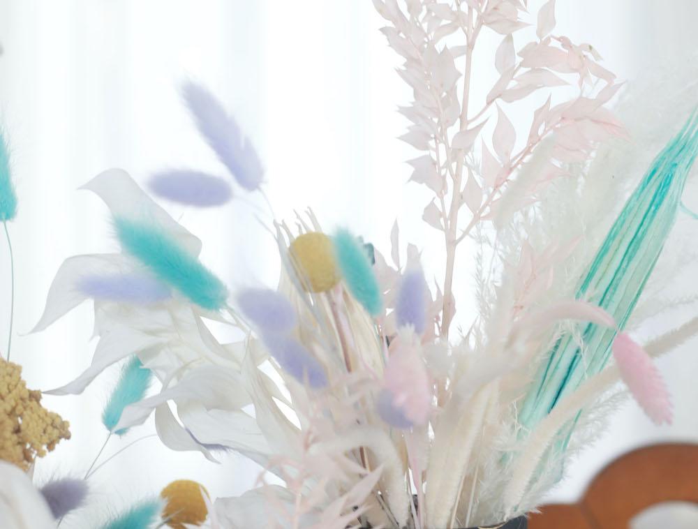 A close-up shot featuring an arrangement of pastel flowers