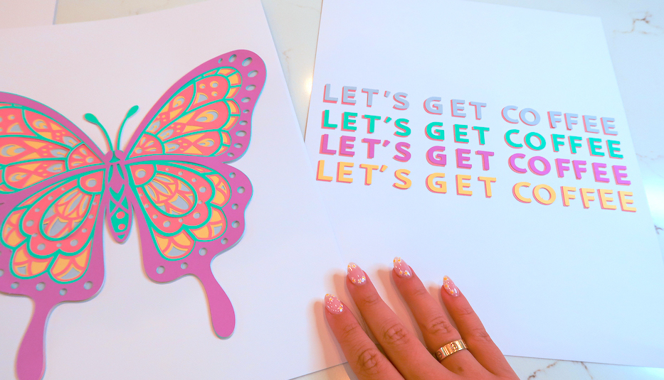 A hand displays two pastel colored pieces of dorm room decor made using Cricut Explore 3 machine