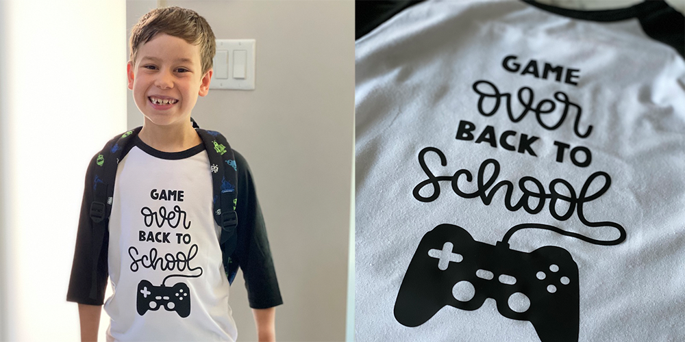 A child proudly wears his Cricut designed back-to-school outfit