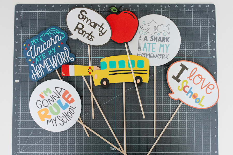 Finalized back-to-school photoshoot props are laid out on a grey mat