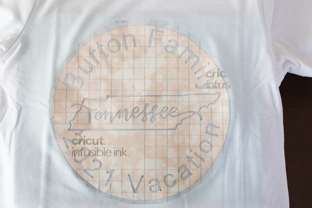 A Cricut infusible ink design for a custom summer outfit it placed on a blank white t-shirt