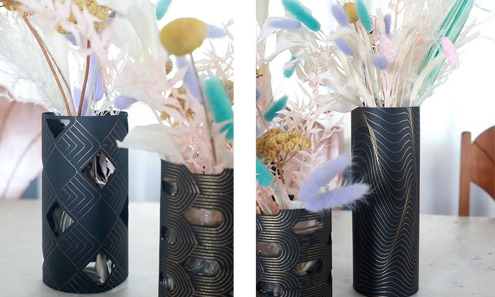 Various closeup shots show 3 pastel colored floral wedding centerpieces sit in Cricut made black paper vase wraps