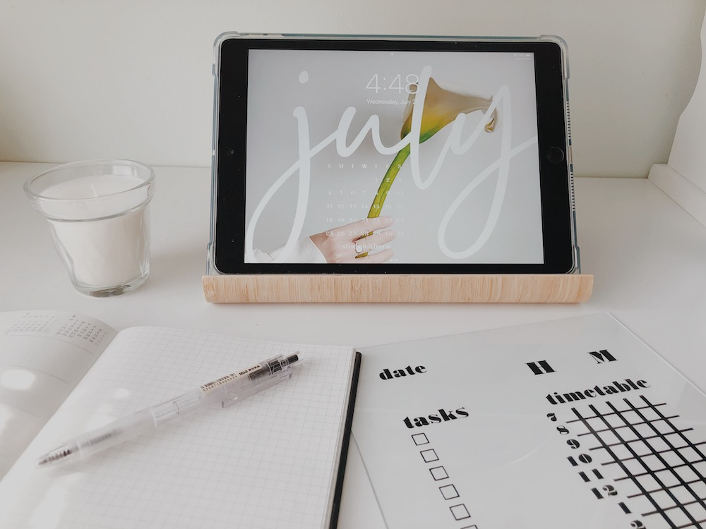 An acrylic study calendar sits on a desktop, functioning as dorm room decor when displayed