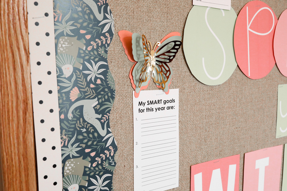 A butterfly made from Cricut materials is attached to a bulletin board