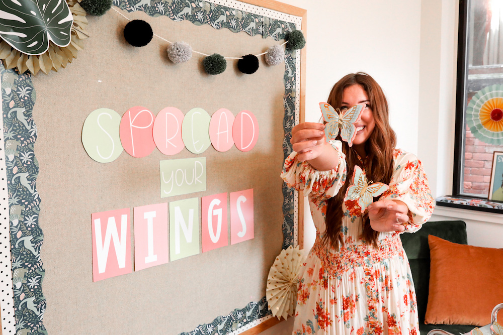 Creator Brittany Jeltema proudly displays her Cricut made bulletin board