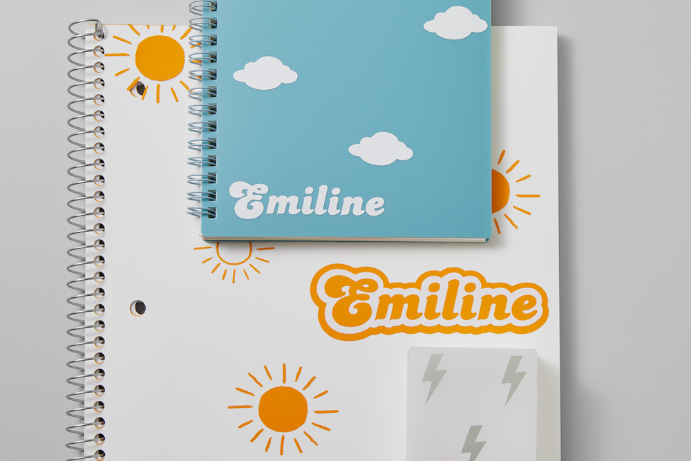 Two notebooks pictured as custom back-to-school supplies sit on a grey background