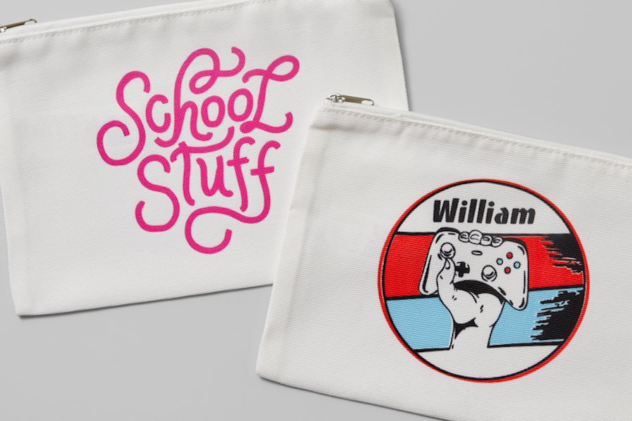 Two pencil cases with iron-on designs sit on a grey background; they're part of a collection of back-to-school supplies