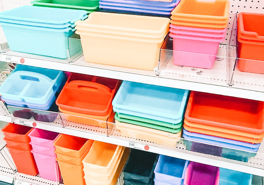A wide array of multicolored tubs sits on a shelf, perfect for purchase to create a back-to-school classroom organization project