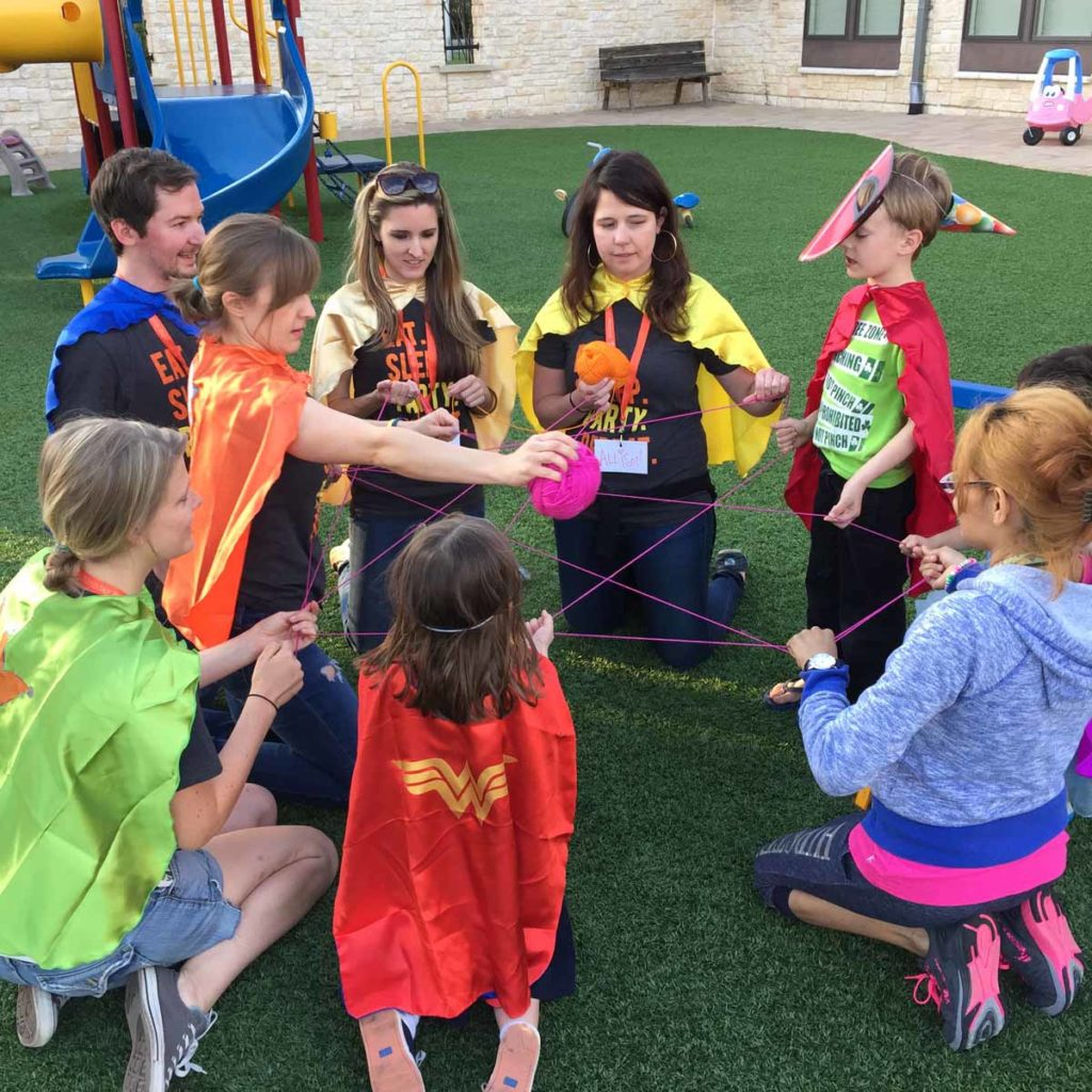 Paige Chenault and children during TBPP activity