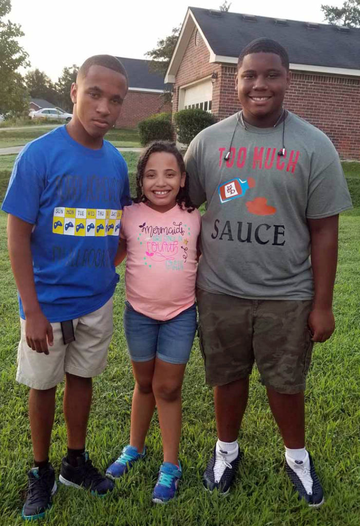 kids wearing back to school shirts