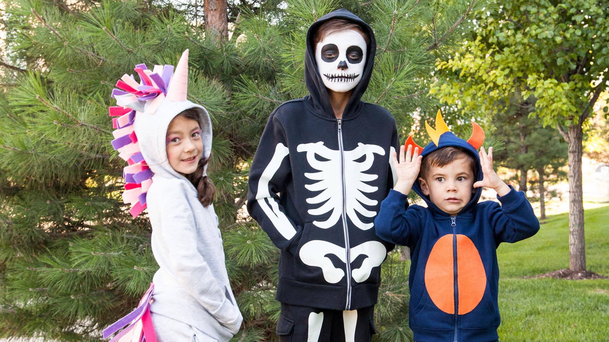 unicorn, skeleton, fish kid costumes