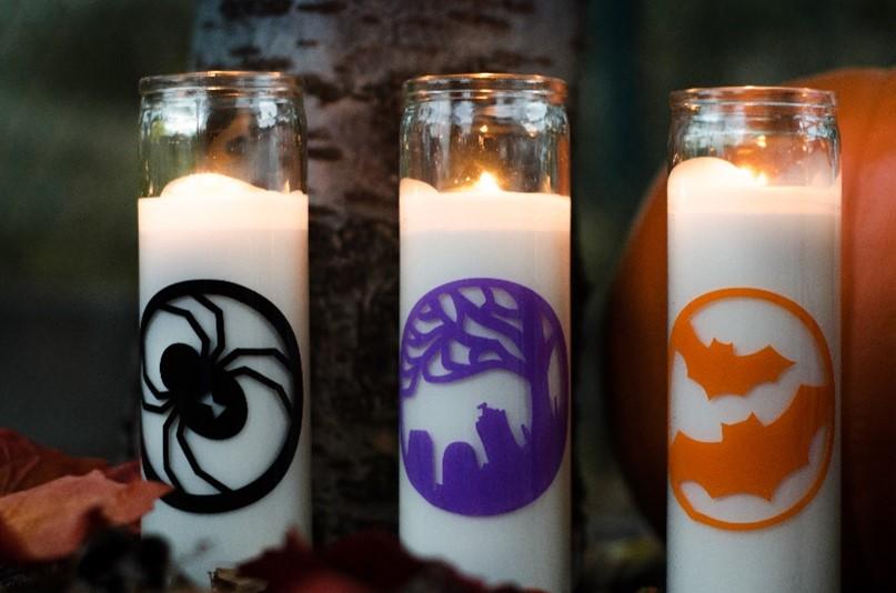 three tall Halloween candles