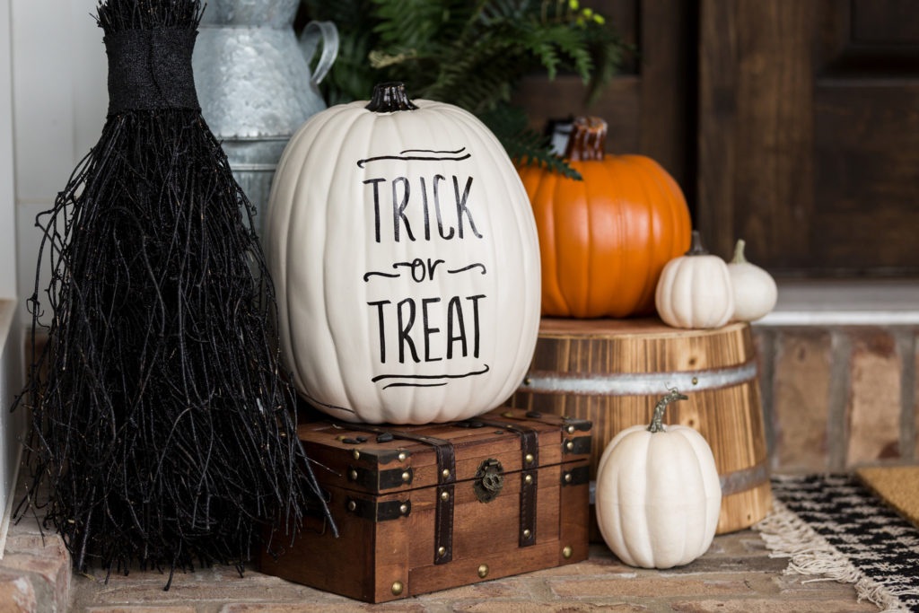 """Pumpkins on doorstep with """"Trick or treat"""" in vinyl decals"""