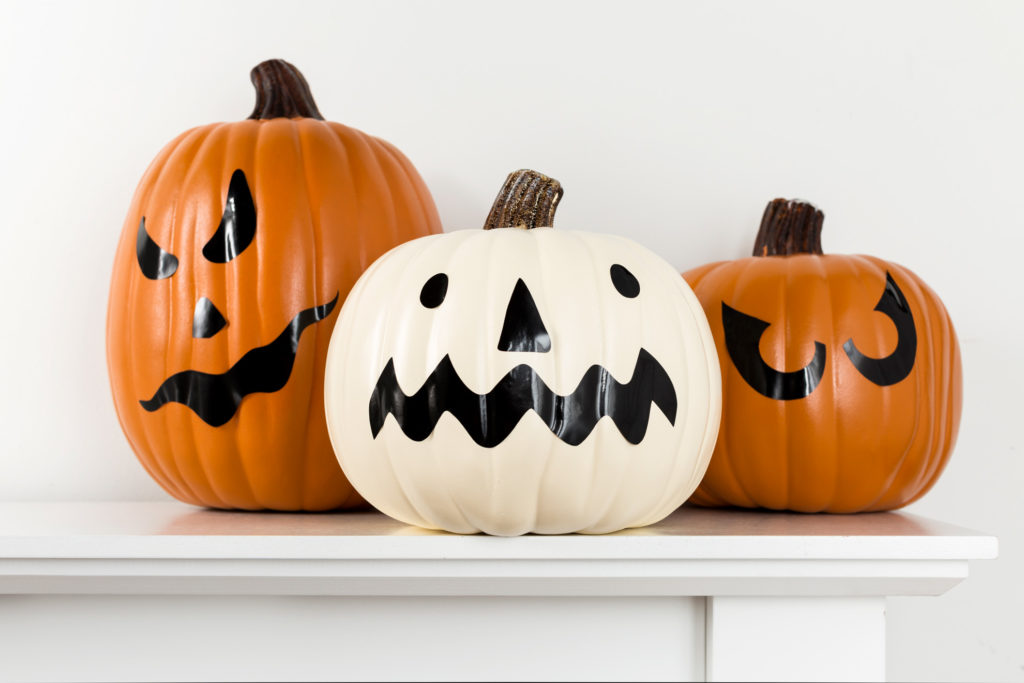 Pumpkins decorated as jack-o-lanterns for Halloween with permanent vinyl