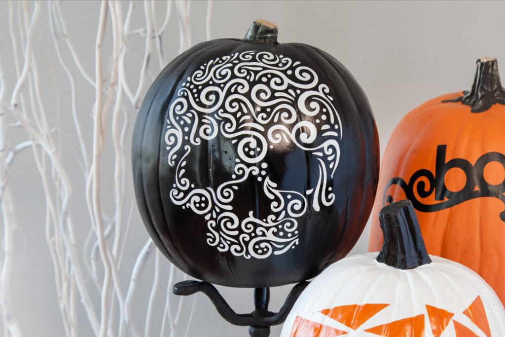 Black pumpkin with white skull design