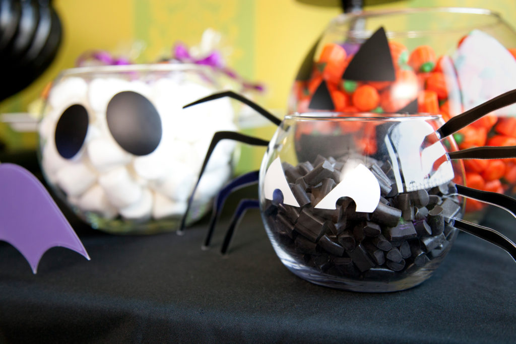 Candy bowls decorated to look like ghosts, spiders, and pumpkins