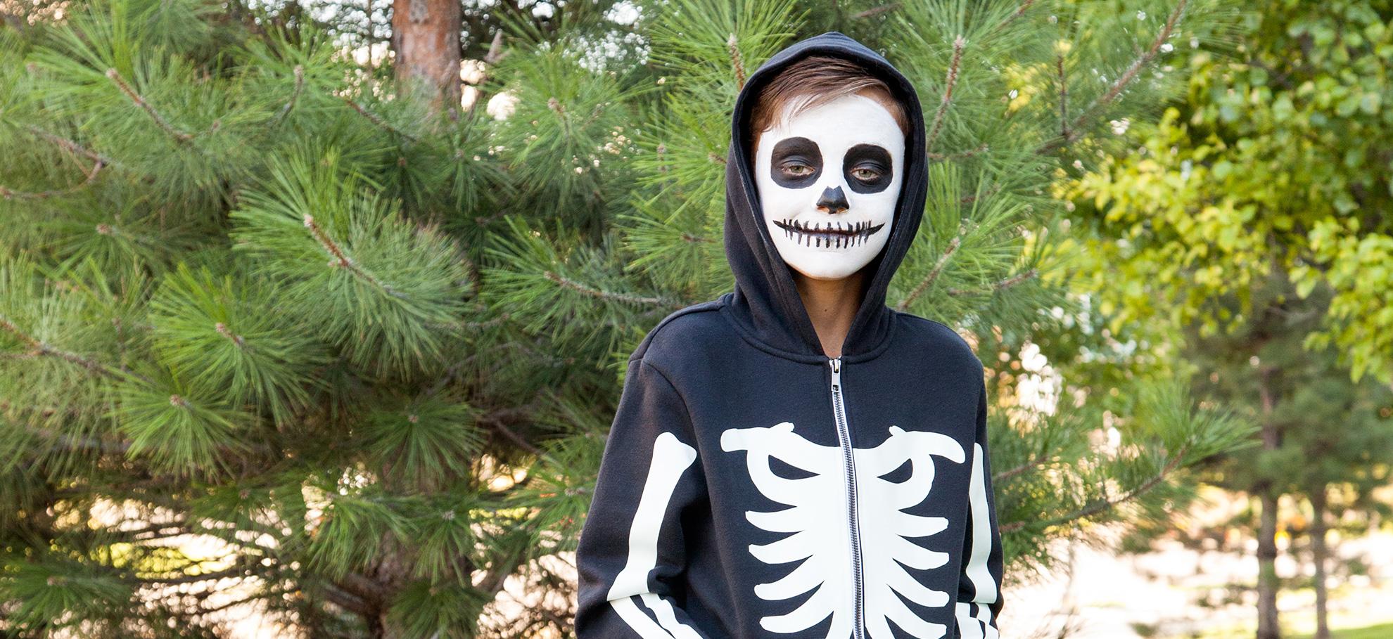 young boy wearing skeleton costume
